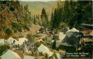 Colorized postcard of tents and bath houses circa 1900-1910.