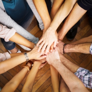 Group of people with pile of hands